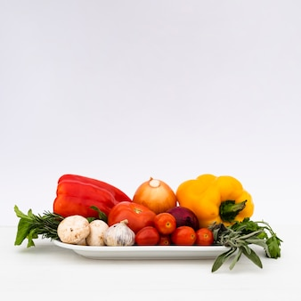 Fresh healthy raw vegetables in tray on white background