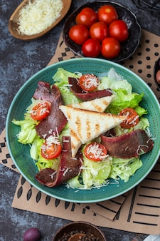 Fresh healthy roastbeef salad with green iceberg and parmesan cheese