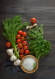 Fresh herbs collection on a wooden background