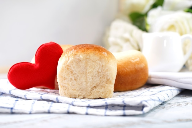 Fresh home made bread on white table with napkin