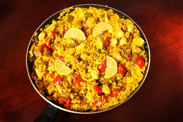 A fresh home made paella served on a frying pan