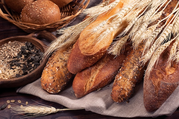 Fresh homemade baguettes placed on a wooden table. bakery food concept  or  banner photo.