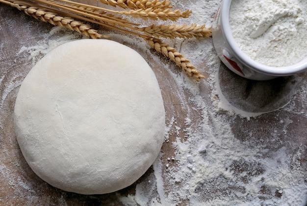 Fresh homemade bread dough on flour
