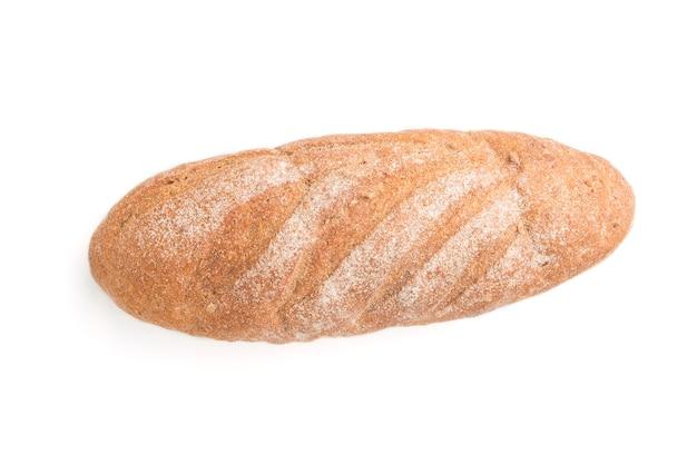 分離した小麦粉と焼きたての自家製パン。平面図、クローズアップ、フラットレイアウト。