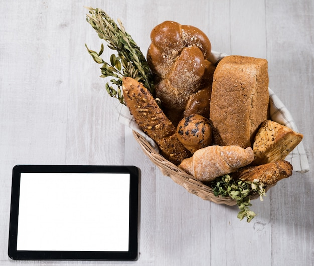 Fresh homemade bread with tablet