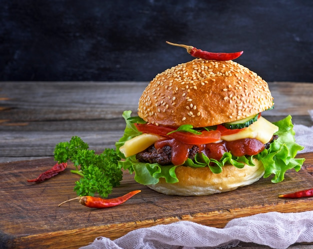 Fresh homemade burger with lettuce, cheese, onion and tomato