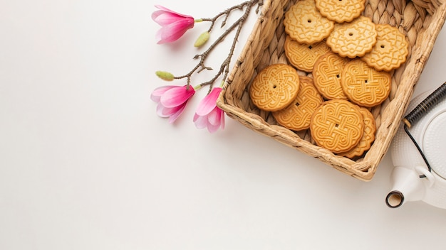 Fresh homemade cookies and flowers with copy space