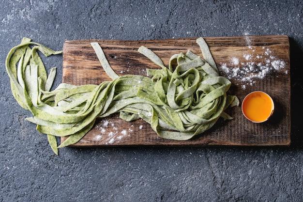 Fresh homemade green pasta tagliatelle