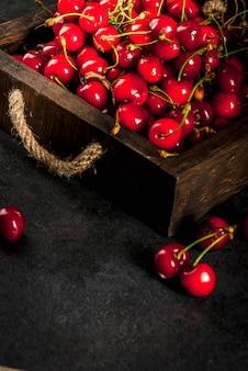 Fresh homemade organic raw cherry.on a black kitchen table copyspace
