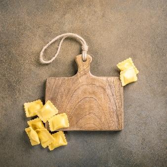 Fresh homemade stuffed square pasta ravioli