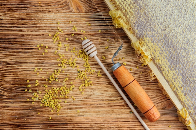 Fresh honey in the comb and the tools of the beekeeper . flat lay and top view
