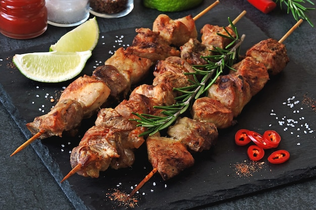Fresh hot kebab with rosemary, lime and chili