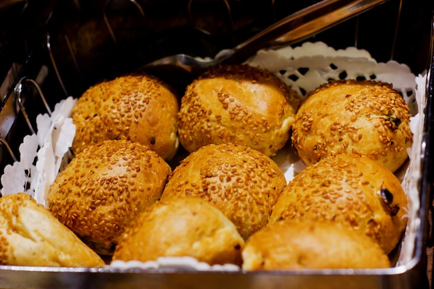 Fresh hot yeast buns with sesame seeds