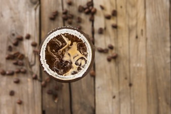 Fresh ice coffee on wooden background