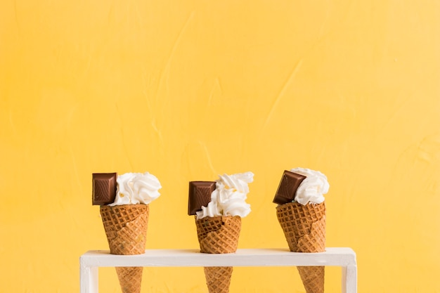 Fresh ice cream scoop in cones with chocolate