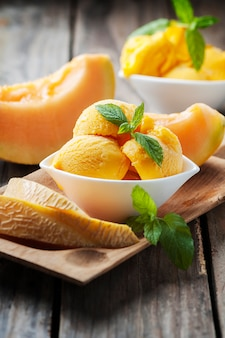 Fresh ice-cream with melon and mint