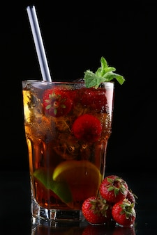 Fresh ice tea with ice and strawberries