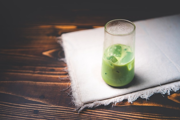 Fresh iced matcha latte green tea beverage cold drink with milk, healthy refreshment food with white sweet cream, delicious about japanese tasty style background