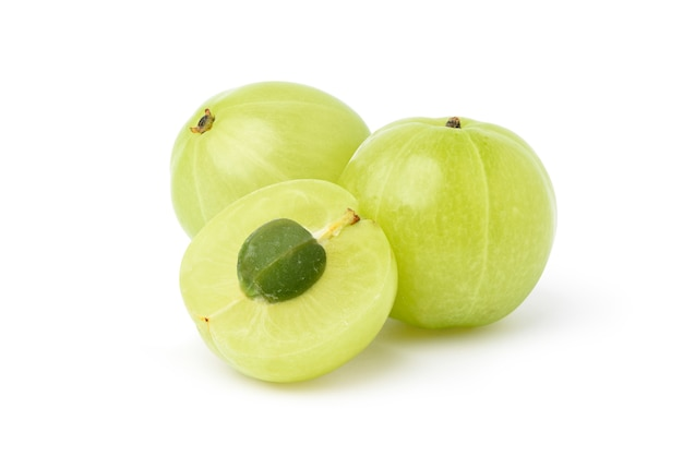 Fresh indian gooseberry fruits with cut in half isolated on white Premium Photo