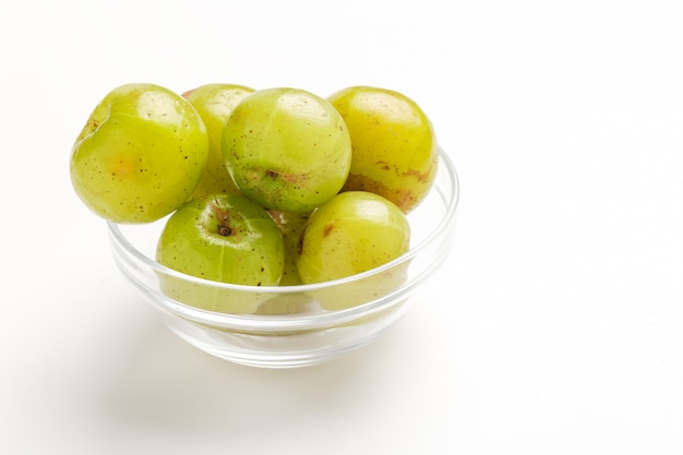 Fresh indian gooseberry in glass bowl