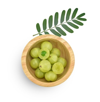 Fresh indian gooseberry in a wooden bowl