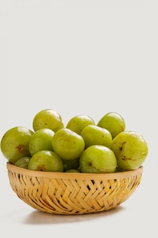Fresh indian gooseberry in wooden  bowl