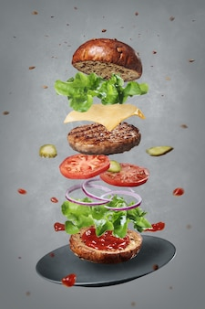 Fresh ingredients of delicious warm burger levitating with a plate