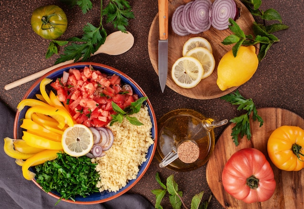 Fresh ingredients for salad with couscous. healthy, vegeterian halal food concept