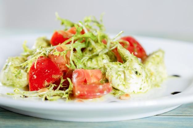 Fresh italian caprese salad with mozarella cheese and tomatoes