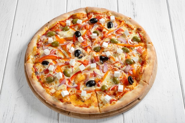 Fresh italian vegetarian pizza on wooden table