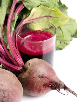 Fresh juice of red beets on white bakcground with copy space close up