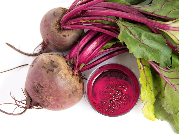 Fresh juice of red beets on white bakcground with copy space top view