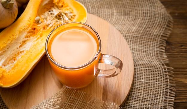 Fresh juice with halved pumpkin arrangement
