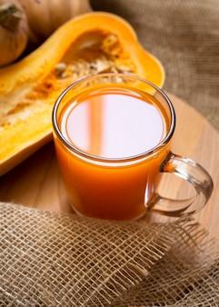 Fresh juice with halved pumpkin