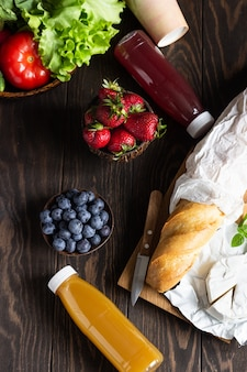 Fresh juices, various vegetables and berries, fresh baguette and cheese