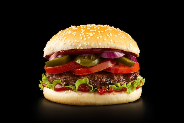 Fresh juicy burger on black background