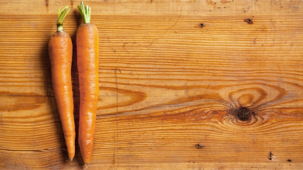 Fresh juicy carrot on a cutting board
