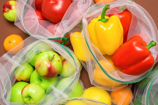 Fresh and juicy fruits and vegetables in reusable eco-friendly mesh bags.