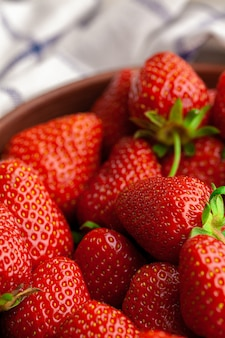 Fresh juicy large strawberry in a bowl. close up.