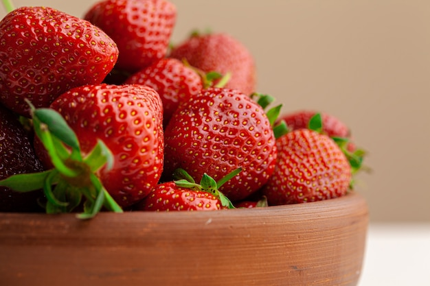 Fresh juicy large strawberry in a bowl.