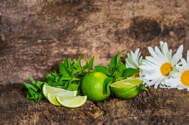 Fresh juicy limes on wooden table. mojito