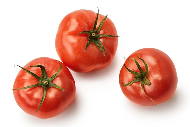 Fresh juicy pink tomatoes isolated on a white background this years crop