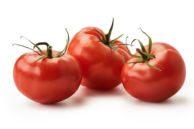 Fresh juicy pink tomatoes isolated on a white background.