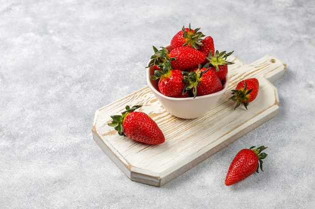 Fresh juicy strawberries on light background,top view