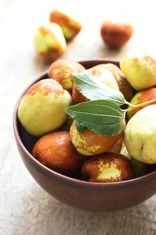 Fresh jujube on wooden table. unabi fruit