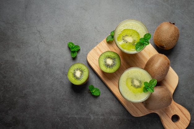 Fresh kiwi, cut into half, put on wooden cutting board