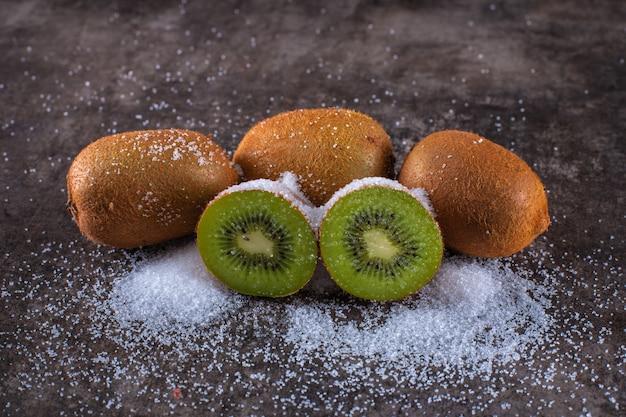 Fresh kiwi fruit covered by the sugar