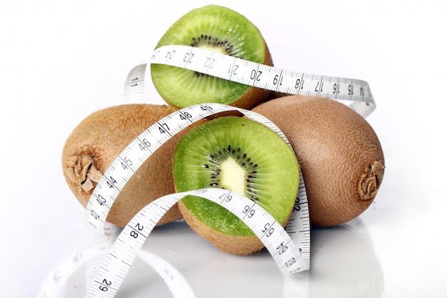 Fresh kiwi and measure tape