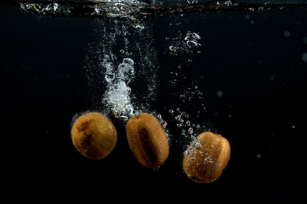 Fresh kiwis in the water