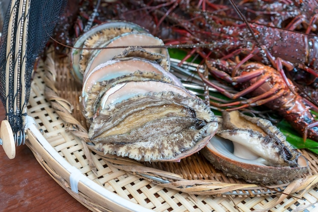 Fresh large abalones prepared for barbecue fire grill in mie, japan
